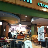 Photo taken at Starbucks by Polina G. on 4/25/2011