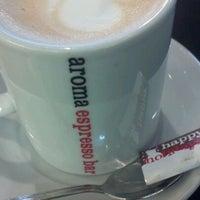 Photo taken at Aroma Espresso Bar by Eden S. on 12/29/2011