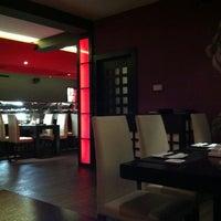 Photo taken at Wasabi Running Sushi & Wok Restaurant by Peter H. on 2/17/2012