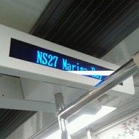 Photo taken at Marina Bay MRT Interchange (NS27/CE2) by Brendan T. on 7/14/2011