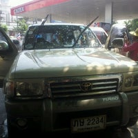 Photo taken at Caltex by Mai M. on 12/12/2011