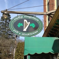 Photo taken at Molly Maguires Pub & Steakhouse by Elizabeth W. on 3/10/2012