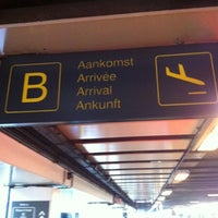Photo taken at Arrivals by Kristof D. on 7/26/2012