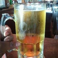 Photo taken at Boston's Restaurant & Sports Bar by Patricio B. on 11/12/2011