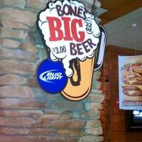 Photo taken at Smokey Bones Bar & Fire Grill by Shannon D. on 1/4/2012