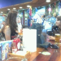 Photo taken at Hooters by Sydney R. on 8/10/2012