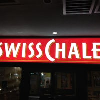 Photo taken at Swiss Chalet by Ferdinand K. on 7/12/2012