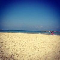 Photo taken at Frishman Beach by Вера on 8/9/2012