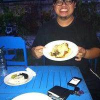 Photo taken at Mojo's Flying Burritos by Arga N. on 7/27/2011