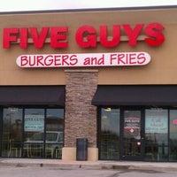 Photo taken at Five Guys by Justin B. on 12/20/2011