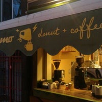 Photo taken at Dynamo Donut & Coffee by Jonathan J. on 10/11/2011
