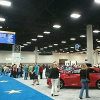 Photo taken at San Diego International Auto Show by Travis C. on 1/1/2012