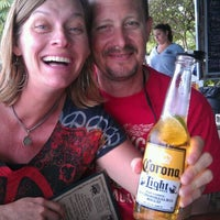 Photo taken at Hogfish Bar & Grill by Lisa V. on 3/28/2012