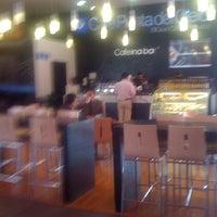 Photo taken at Café Punta Del Cielo by Lily O. on 4/8/2011
