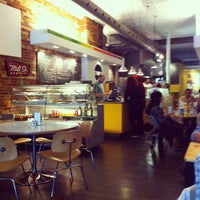 Photo taken at Arepa Cafe by Corey E. on 3/24/2012