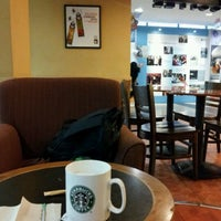 Photo taken at Starbucks by Adrian E. on 10/19/2011