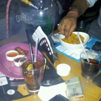 Photo taken at V Spot Bar + Cafe by Siddharth on 3/17/2012