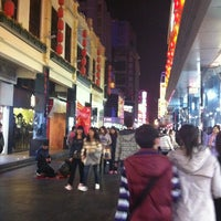 Photo taken at 东门步行街 Dongmen Pedestrian Zone by Samantha Q. on 12/11/2011