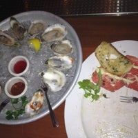 Photo taken at McCormick & Schmicks Seafood Restaurant by John G. on 4/1/2012
