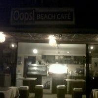 Photo taken at Oops Beach Cafe by Marie D. on 8/12/2012