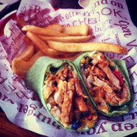 Photo taken at Red Robin Gourmet Burgers by Bella B. on 3/2/2012