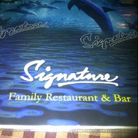 Photo taken at Signature by Roxanne G. on 10/6/2011