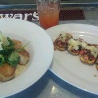 Photo taken at Dine Restaurant by Carlie M. on 10/24/2011