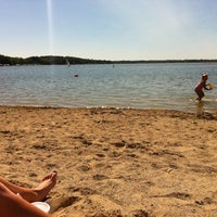 Photo taken at Pewaukee Beach by Maddie G. on 8/27/2012