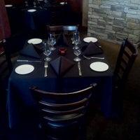Photo taken at Eros Restaurant & Bar by Eric O. on 3/20/2012