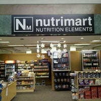 Photo taken at Nutrimart-Parkway Plaza by Eric G. on 12/9/2011