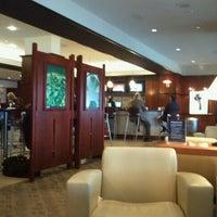 Photo taken at Terminal B by Roberto C. on 12/5/2011