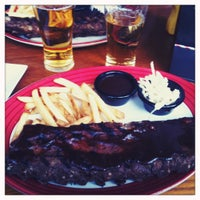Photo taken at T.G.I. Friday's by Lauri S. on 4/25/2012