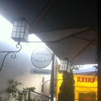 Photo taken at Mandalun Restaurante by Leticia A. on 2/19/2012