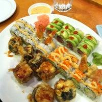 Photo taken at Sushi Thai by Allison E. on 1/7/2012