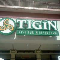 Photo taken at Tigín Irish Pub and Restaurant by Sabrina L. on 3/26/2012