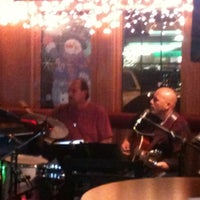 Photo taken at Downing St Bar & Grill by Brett K. on 12/17/2011