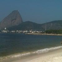 Photo taken at Praia do Flamengo by Vanessa G. on 7/28/2012
