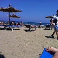 Photo taken at Mackenzy Beach by Theoklis A. on 5/6/2012