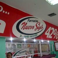 Photo taken at Farmacia Nuevo Siglo by Carlos B. on 7/22/2011