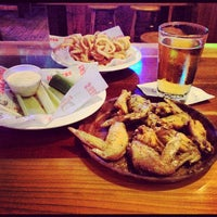 Photo taken at Hooters by Anthony C. on 9/1/2012