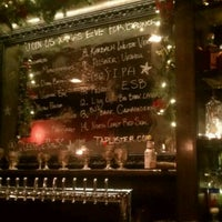 Photo taken at The Queen Vic Pub & Kitchen by David S. on 12/27/2011