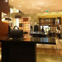 Photo taken at Louis Vuitton by Daria L. on 12/15/2011
