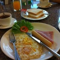Photo taken at Cozy Villa Hotel by JieQi T. on 3/3/2012