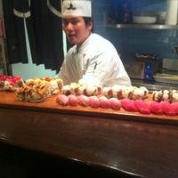 Photo taken at Okura Robata Sushi Bar and Grill by Ken J. on 11/5/2011