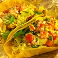 Photo taken at El Pelon Taqueria by Lisa on 11/10/2011