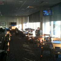 Photo taken at Delta Sky Club by Scott M. on 1/24/2012