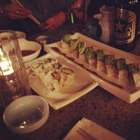 Photo taken at Rock N Roll Sushi by Desiree Kae T. on 4/6/2012