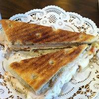 Photo taken at Arosa Cafe by Katherine S. on 1/27/2012