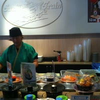 Photo taken at Sushi Train by Alex S. on 3/30/2012