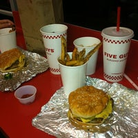 Photo taken at Five Guys by Stephanie L. on 3/6/2012
